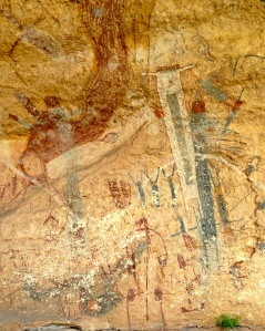 Figures in White Shaman shelter . Note little man in canoe at bottom of picture.