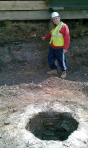A current excavation by Schuldenrein in the Upper West Side of Manhattan. He is pointing to a 19th century well