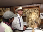 Jack Skiles talks to visitors in his museum.